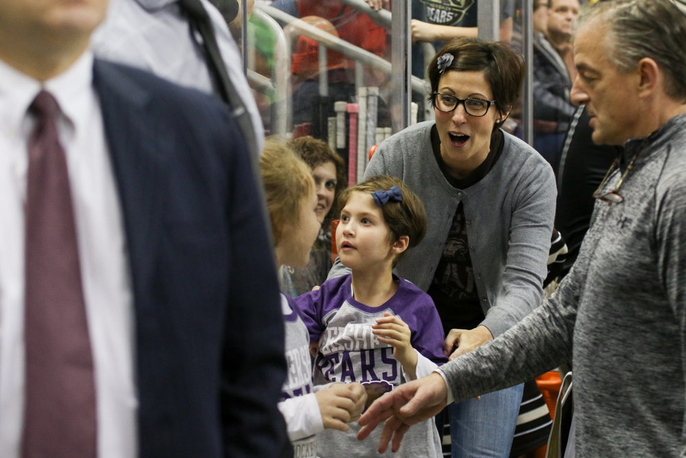 Kennedy Stevenson, Center, Looks Up Into The Stands As Her Mother Walks With Her Onto The Hershey Bears Bench.
