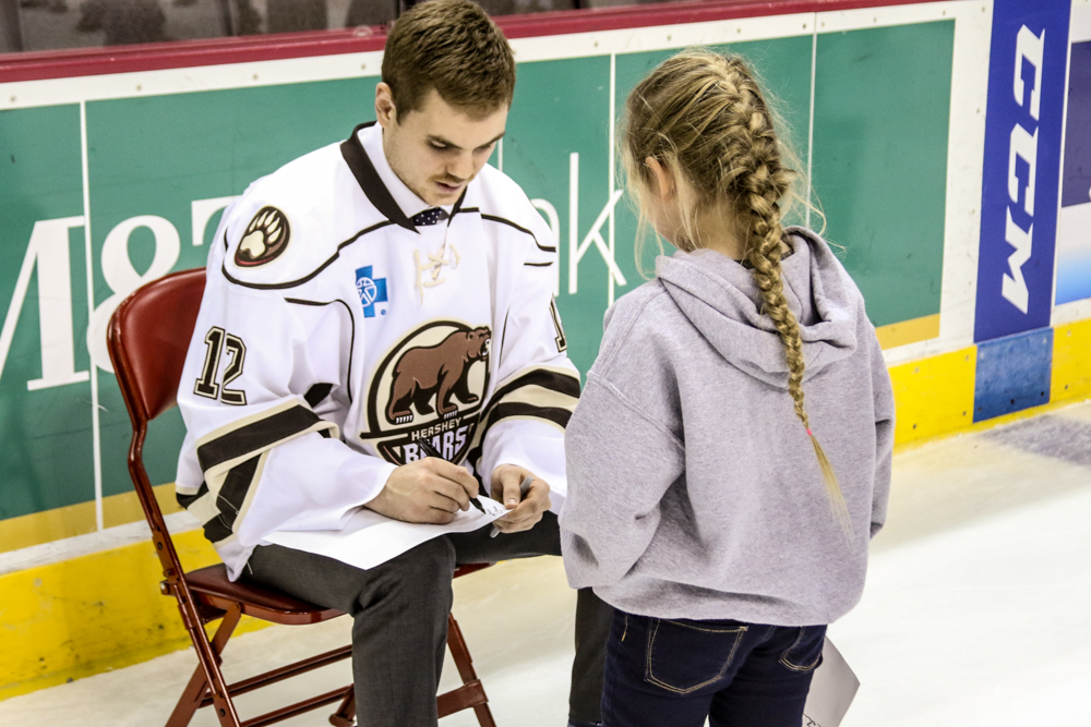 Jeremy Langlois Signs For A Young Fan.