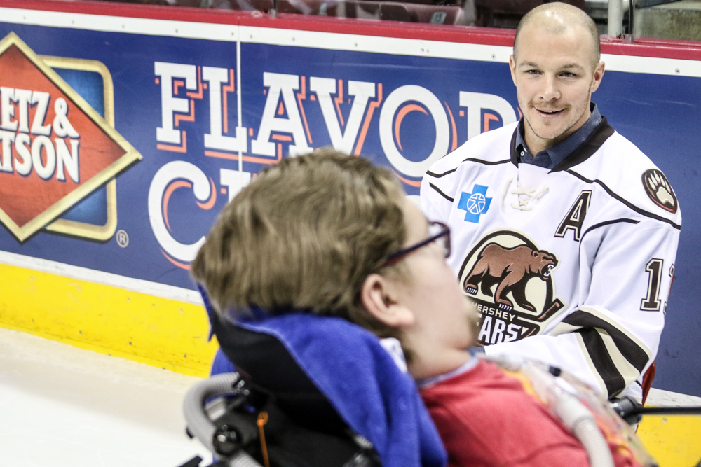 Zach Sill Greets A Fan Before Taking A Photo