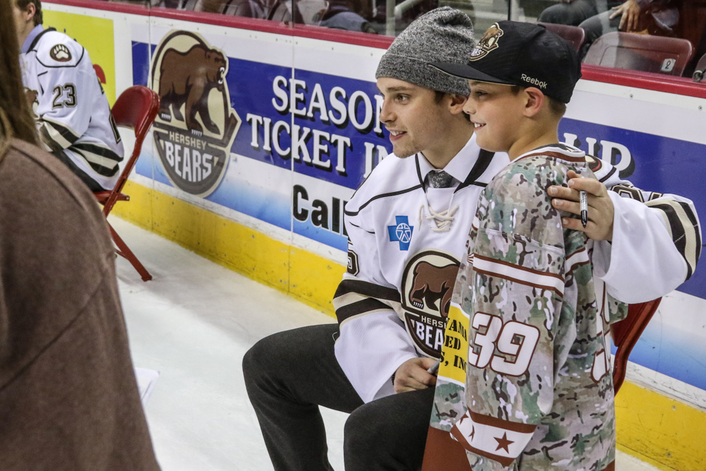 Colby Williams Poses With A Young Hockey Player
