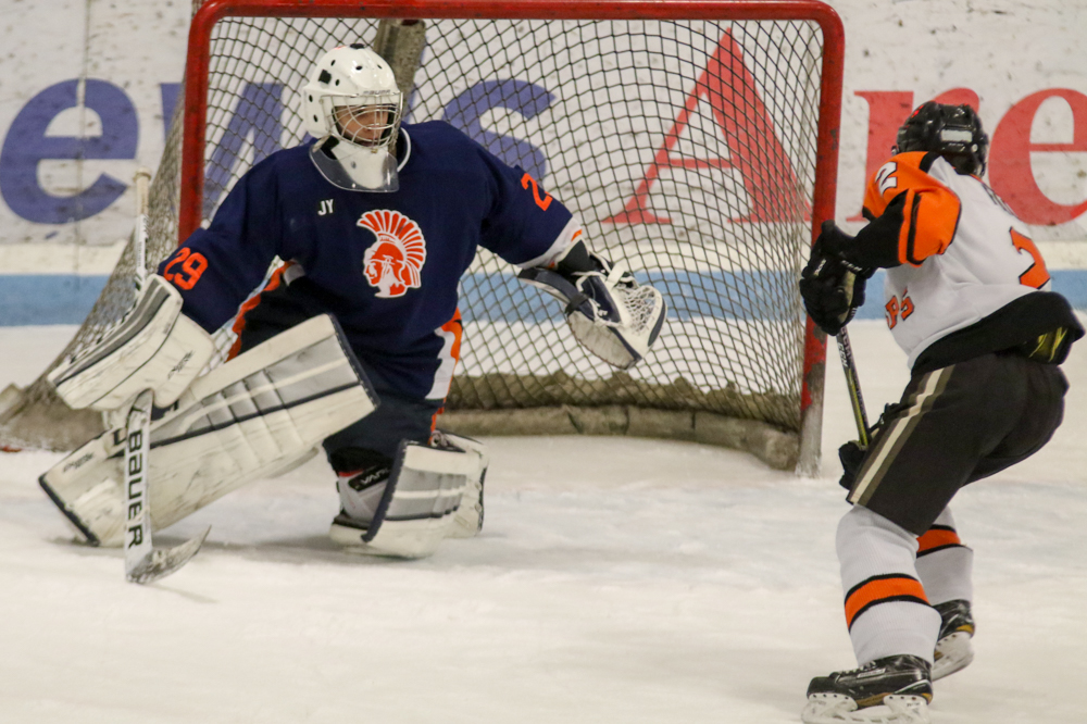Chris Larkin Goes To Make A Save Against A Palmyra Player.