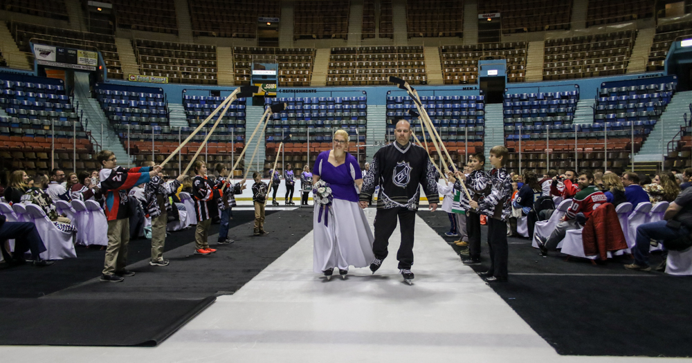 Hockey themed wedding features custom jerseys and a skating bride and groom at Hersheypark Arena